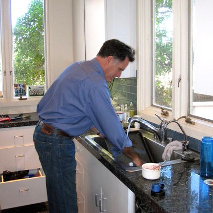 Normal guy Mitt Romney washing some dishes.