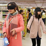 Volunteers attempt to shop blindfolded during an event to mark the International Day of Persons with Disabilities, at a supermarket in Mianyang, Sichuan province, China December 3, 2014.