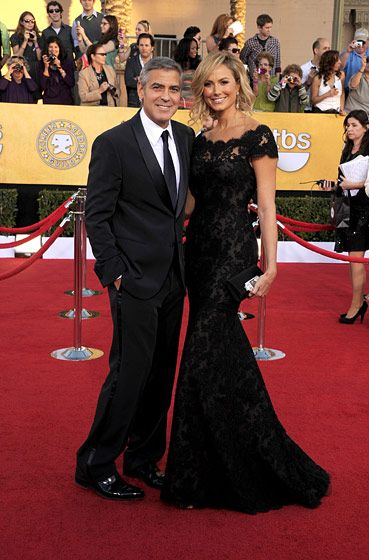 LOS ANGELES, CA - JANUARY 29:  (L-R) Actors George Clooney (L) and Stacy Keibler arrive at the 18th Annual Screen Actors Guild Awards at The Shrine Auditorium on January 29, 2012 in Los Angeles, California.  (Photo by Jason Merritt/Getty Images)