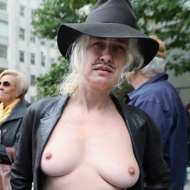 Topless nudity activist Holly Van Voast poses during the annual Columbus Day Parade on October 8, 2012 in New York City. The Italian-American parade was launched in 1929 and is billed as the world's largest celebration of Italian-American heritage featuring more than 35,000 participants.