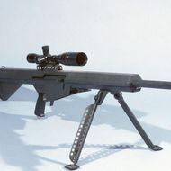 A Barrett light .50-caliber sniper rifle with scope.
