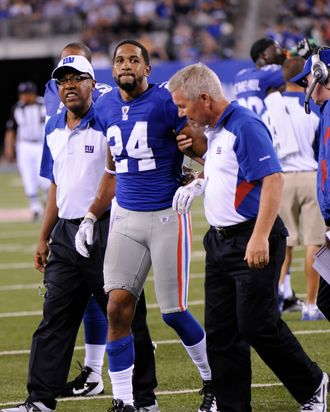New York Giants cornerback Terrell Thomas (24) is helped off the field by trainers during the second quarter of an NFL preseason football game against the Chicago Bears Monday, Aug. 22, 2011, in East Rutherford, N.J.