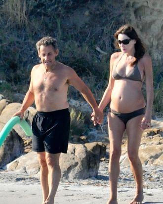 Nicolas Sarkozy, Carla Bruni, and a pool noodle.