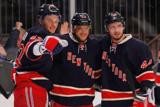 NEW YORK, NY - DECEMBER 11: Marian Gaborik #10 of the New York Rangers celebrates a second period goal with teammates Steve Eminger #44 and Artem Anisimov #42 during the game against the Florida Panthers at Madison Square Garden on December 11, 2011 in New York City.  (Photo by Mike Stobe/Getty Images)