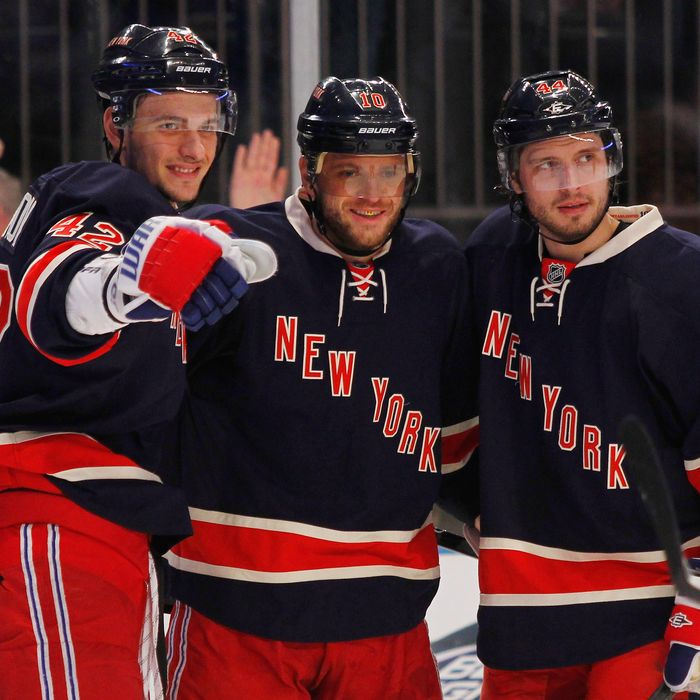 Marian Gaborik #10 of the New York Rangers celebrates a second period goal with teammates Steve Eminger #44 and Artem Anisimov #42 during the game against the Florida Panthers at Madison Square Garden on December 11, 2011 in New York City.