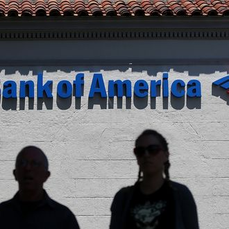 SAN ANSELMO, CA - JULY 18: People walk by a Bank of America branch office on July 18, 2012 in San Anselmo, California. Bank of America reported second quarter net income of $2.5 billion, or 19 cents per share comapred to a loss of $8.8 billion, or 90 cents per share one year ago. (Photo by Justin Sullivan/Getty Images)