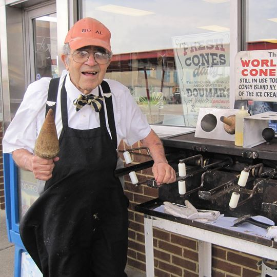 Doumar, with the ice-cream-cone-making machine used in 1905 on Coney Island.
