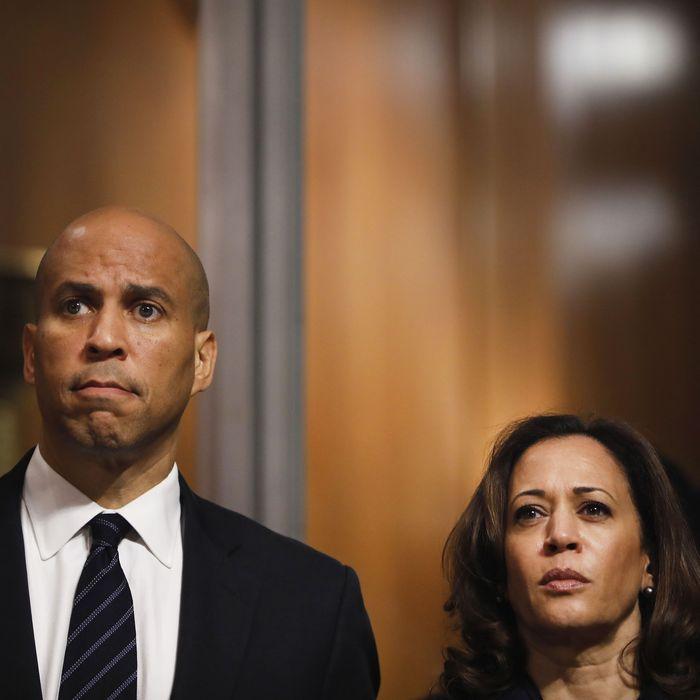 Senators Cory Booker (left) and Kamala Harris (right).