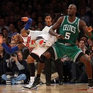 Kevin Garnett #5 of the Boston Celtics and Carmelo Anthony #7 of the New York Knicks bump at Madison Square Garden on January 7, 2013 in New York City.