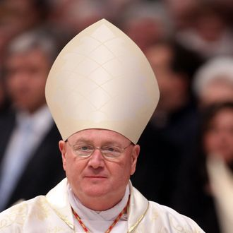VATICAN CITY, VATICAN - FEBRUARY 19: Newly Appointed cardinal Timothy Michael Dolan Archbishop of New York attends a mass held by pope Benedict XVI in St. Peer's Basilica on February 19, 2012 in Vatican City, Vatican. The 84 year old Pontiff installed 22 new cardinals during his fourth concistory, who will be responsible for choosing his sucessor. (Photo by Franco Origlia/Getty Images)