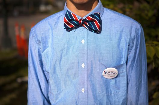 A young man supports Republican Presidential Candidate, Mitt Romney, outside the first Presidential Debate at the University of Denver on Wednesday, October 3, 2012.  Included in the topics of discussion by President Barack Obama and Republican Presidential Candidate, Mitt Romney, were healthcare, the role of the government, taxes, and job creation.
