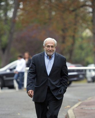 Former IMF chief Dominique Strauss-Kahn arrives to a polling station for the Socialist party's (PS) 2011 primary vote for France's 2012 presidential election on October 9, 2011 in Sarcelles, northern suburb of Paris. The Socialists are hoping that hundreds of thousands of people will head to the voting centres specially set up for the primary vote held in two rounds today and October 16. Strauss-Kahn was forced to resign as managing director of IMF when he was arrested in May 2011 and charged with the sexual assault and attempted rape of hotel maid Nafissatou Diallo in his suite at the Sofitel hotel in Manhattan. Strauss-Kahn, who was seen as a frontrunner in next year's French presidential election before the charges were brought against him, returned to France on September 4. AFP PHOTO / MIGUEL MEDINA (Photo credit should read MIGUEL MEDINA/AFP/Getty Images)