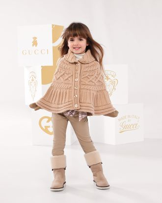 A fabulous Gucci-wearing child.