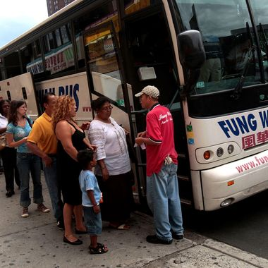 Passengers prepare to load a Fung Wah bus before leaving Manhattan for Boston August 4, 2008 in New York.  With fuel prices skyrocking, bus services have seen an increase in ridership in recent months.