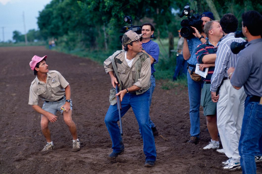 01 Sep 1994, Houston, Texas, USA --- Journalists accompany Texas governor candidate George W. Bush on his hunting expedition in a field on opening day of dove season in Houston. --- Image by ? Greg Smith/CORBIS