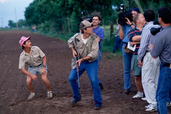 01 Sep 1994, Houston, Texas, USA --- Journalists accompany Texas governor candidate George W. Bush on his hunting expedition in a field on opening day of dove season in Houston. --- Image by © Greg Smith/CORBIS