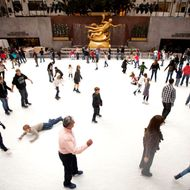 People ice skate at Rockefeller Center  on November 26, 2011 in New York City.  With the holidays less than a month away and as is tradition, Manhattan retailers have decorated their department store displays for the season with elaborate designs and animated scenes.