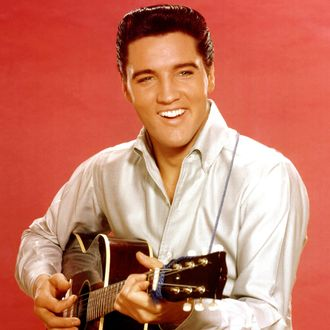 Elvis Presley portrait with acoustic guitar