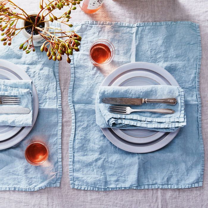 Blue linen napkins and placemats at a table setting — The Strategist reviews all the best linen to buy right now.