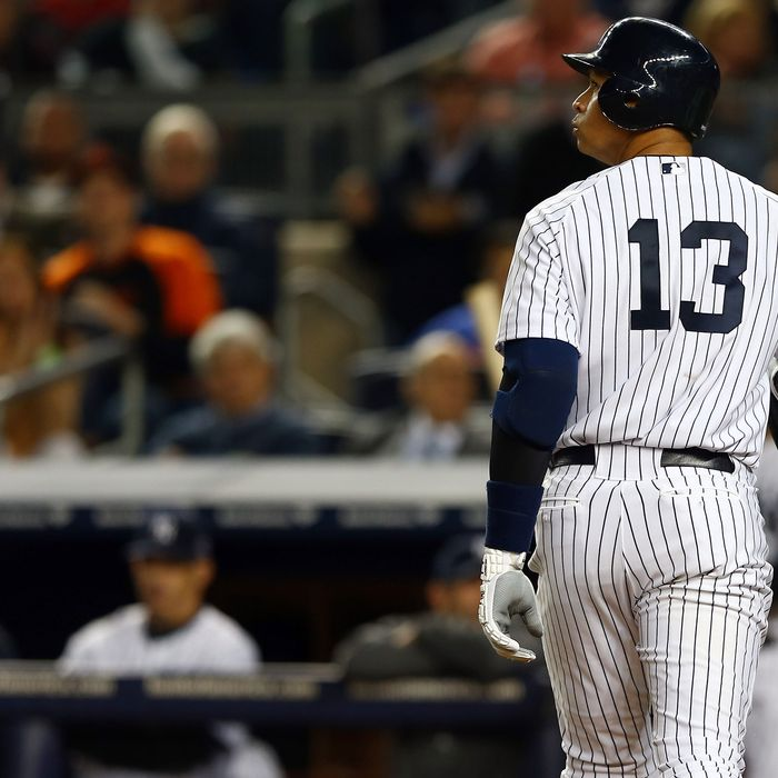 Alex Rodriguez #13 of the New York Yankees looks on after striking out against the Baltimore Orioles during Game Three of the American League Division Series at Yankee Stadium on October 10, 2012 in the Bronx borough of New York City.
