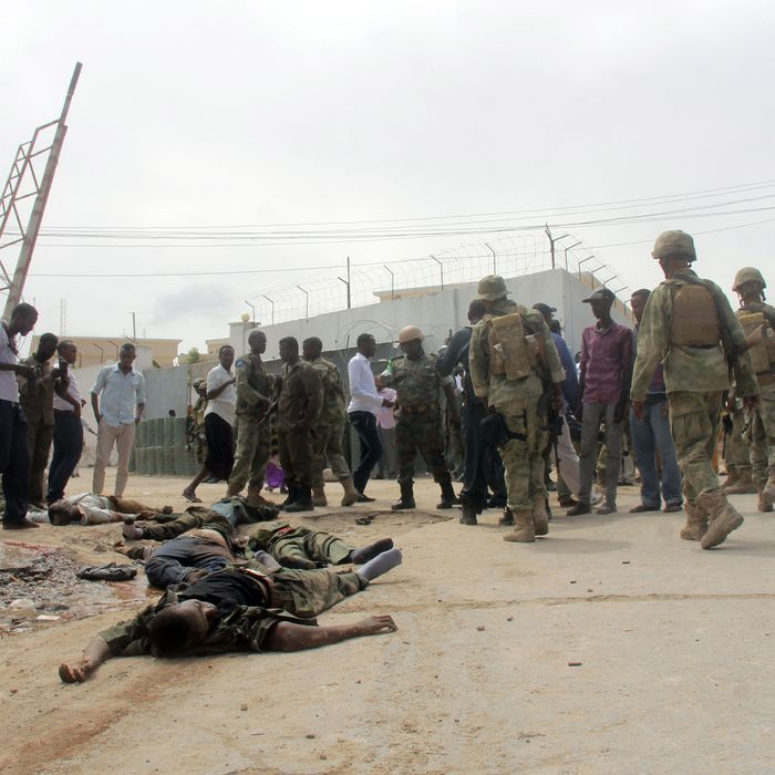 Bodies of suspected Al Shabaab militants lay on the ground after a bomb explosion in Mogadishu, capital of Somalia, Aug. 31, 2014. At least seven Al Shabaab militants were on Sunday killed after they launched a suicide car bomb explosion near a high security prison in Mogadishu.