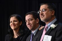 Laura Poitras (L) and Glenn Greenwald (C), in the US for the first time since documents were disclosed to them by former intelligence analyst Edward Snowden, accept Long Island University's George Polk Award for National Security Reporting April 11,2014 in New York.