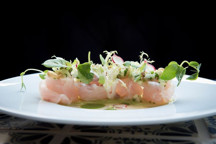Black bass with tomatillo, radish, smoked pickled ramp ponzu, and chives.