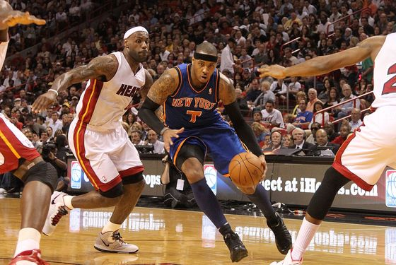 MIAMI, FL - FEBRUARY 27:  Carmelo Anthony #7 of the New York Knicks drives past LeBron James #6 of the Miami Heat during a game at American Airlines Arena on February 27, 2011 in Miami, Florida. NOTE TO USER: User expressly acknowledges and agrees that, by downloading and/or using this Photograph, User is consenting to the terms and conditions of the Getty Images License Agreement.  (Photo by Mike Ehrmann/Getty Images)