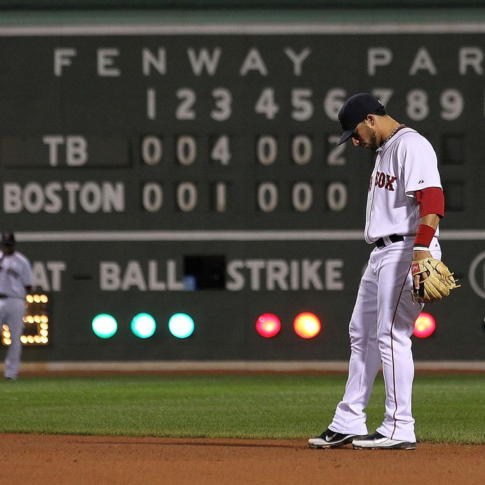 BOSTON, MA - SEPTEMBER 15: Mike Aviles #3 of the Boston Red Sox kicks the dirt in the ninth inning during a game with Tampa Bay Rays at Fenway Park September 15, 2011 in Boston, Massachusetts. The Red Sox lost 9-1. (Photo by Jim Rogash/Getty Images)