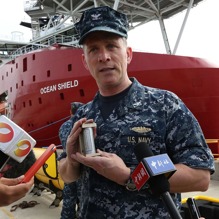 PERTH, AUSTRALIA - MARCH 30: US Navy Capt. Mark Matthews holds an Acoustic Pinger in front of ADV Ocean Shield at HMAS Stirling, Garden Island on March 30, 2014 in Perth, Australia. The Australian Defence vessle, Ocean Shield, will depart for the missing flight MH370 search area from Perth in the coming days, equipped with special US Navy equipment designed to locate an aircrafts 'pinger' and black box. Several objects have been sighted fin the Indian Ocean over the past few days, but none confirmed to be related to the missing airliner. The Malaysian airlines flight disappeared on March 8 with 239 passengers and crew on board and is suspected to have crashed into the southern Indian Ocean. (Photo by Matt Jelonek/Getty Images)
