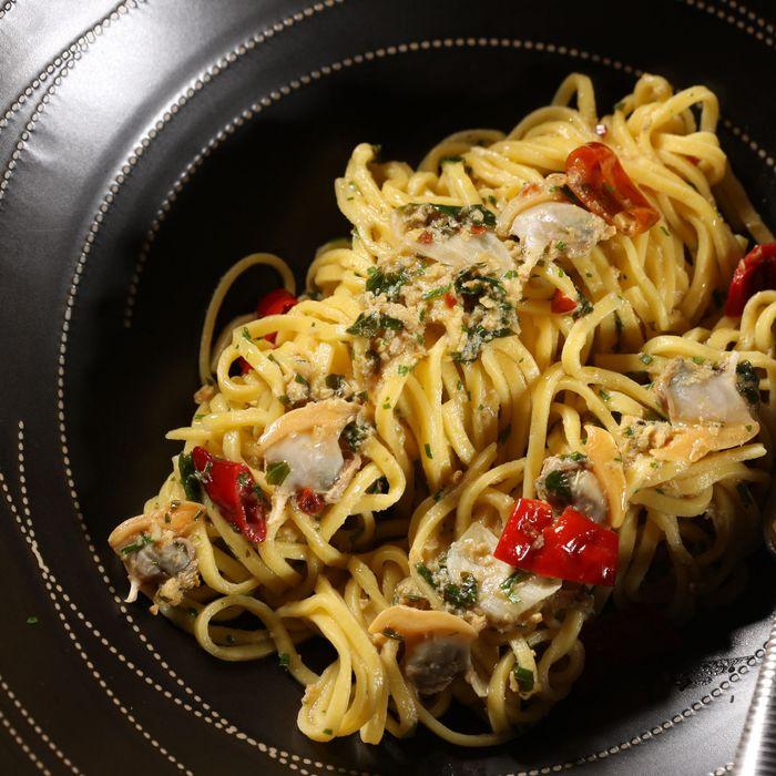 Spaghetti with Manila clams, ramazotti, and Madras curry.