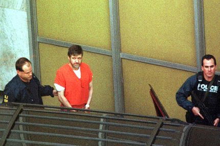 Unabomber suspect Theodore Kaczynski (C) is lead out by armed US marshalls at the Federal Courthouse 22 January in Sacramento, CA.  Kaczynski admitted he was the Unabomber, pleading guilty to all counts.