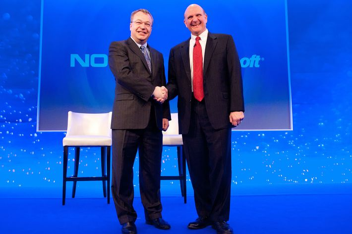 """Nokia Chief Executive Stephen Elop (L) shakes hands with Microsoft CEO Steve Ballmer (R) during the Nokia Strategy and Financial Briefing at the Intercontinental Hotel in central London, on February 11, 2011.  Nokia, the world's largest mobile phone maker, said Friday it was joining forces with US giant Microsoft in a major corporate strategy shake-up that left investors disappointed. The Finnish phone maker said Microsoft's Windows Phone would now serve as its primary smartphone platform in a """"broad strategic partnership"""" destined to regain market share from competitors Apple and Google."""