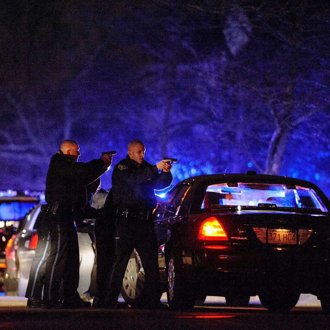 Cops hunt for a suspect on Walnut St. on Friday, Apr. 19, 2013 in Watertown, Mass.  One suspect is dead, but another remains at large following violent incidents overnight that took the life of a police officer and shook the outskirts of the city.  Authorities confirmed early Friday that the incidents in Cambridge and Watertown, Mass., were directly connected to the Boston Marathon attack Monday. (Photo by James Keivom/NY Daily News via Getty Images