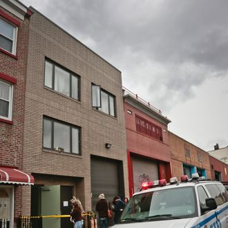 A police vehicle parks outside the location of a Monday shooting rampage, Tuesday, Nov. 12, 2013 in Brooklyn, New York. Police said gunman Ali Akbar Mahammadi Rafie, 29, a musician, killed himself on the roof after shooting to death two members of the Iranian indie rock band Yellow Dogs, a third musician and wounding a fourth person early Monday morning. The shooter was a member of another band from Iran, the Free Keys, who knew the victims but hadn't spoken to them in months because of a