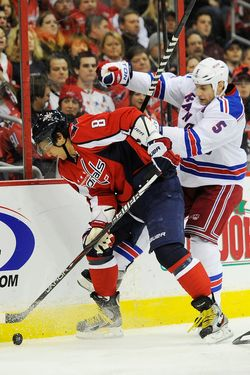 WASHINGTON, DC - DECEMBER 28:  Alex Ovechkin #8 of the Washington Capitals battles for the puck against Daniel Girardi #5 of the New York Rangers during the third period at Verizon Center on December 28, 2011 in Washington, DC.  (Photo by Patrick McDermott/Getty Images)