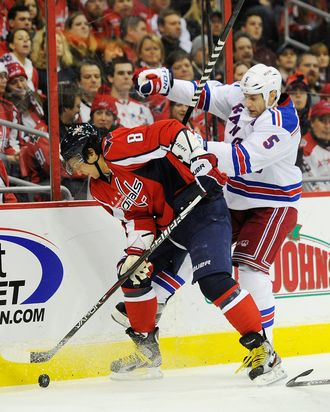 Alex Ovechkin #8 of the Washington Capitals battles for the puck against Daniel Girardi #5 of the New York Rangers