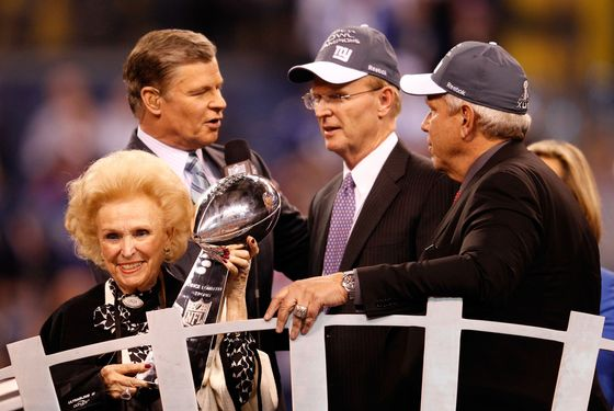 INDIANAPOLIS, IN - FEBRUARY 05:  Co-Owners of the New York Giants John Mara, Steve Tisch and Ann Mara pose with the Vince Lombardi trophy after defeating the New England Patriots 21-17 during Super Bowl XLVI at Lucas Oil Stadium on February 5, 2012 in Indianapolis, Indiana.  (Photo by Rob Carr/Getty Images)