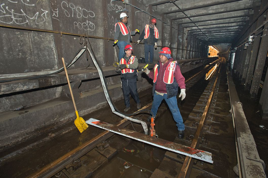 New York City Transit employees are pumping water out of the flooded A Line tunnel near Dyckman Street in Upper Manhattan.