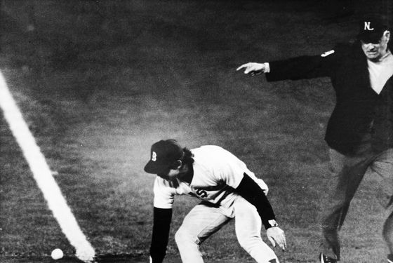 BOSTON - OCTOBER 25: Bill Buckner's error allows winning run to close. (Photo by Stan Grossfeld/The Boston Globe via Getty Images)