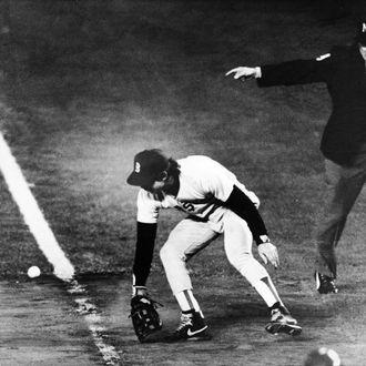 BOSTON - OCTOBER 25: Bill Buckner's error allows winning run to close. (Photo by Stan Grossfeld/The Boston Globe via Getty Images)