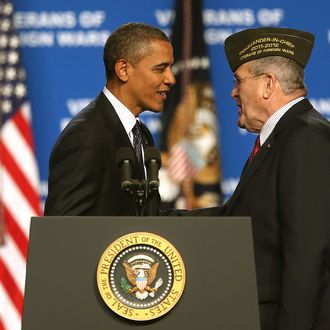 RENO, NV - JULY 23: U.S. President Barack Obama (L) greets Veterans of Foreign Wars Commander-in-Chief Richard L. DeNoyer before speaking speaks at the 113th National Convention of the Veterans of Foreign Wars of the U.S. at the Reno-Sparks Convention Center on July 23, 2012 in Reno, Nevada. President Obama addressed the 113th National Convention of the Veterans of Foreign Wars one day after visiting families of shooting victims in Aurora, Colorado. (Photo by Justin Sullivan/Getty Images)