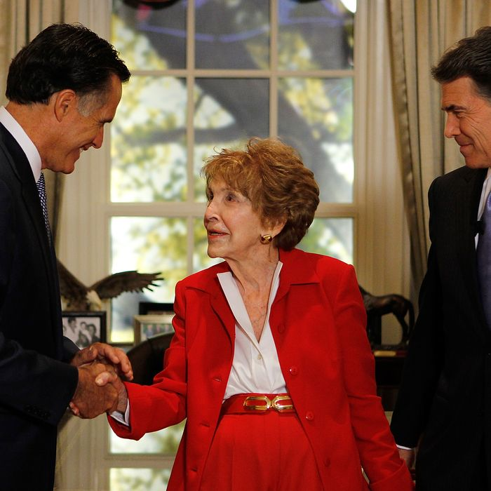 SIMI VALLEY, CA - SEPTEMBER 7: First lady Nancy Reagan (C) is greeted by candidates Mitt Romney (L) and Texas Gov. Rick Perry before the start of the Ronald Reagan Centennial GOP Presidential Primary Candidates Debate at the Ronald Reagan Presidential Library on September 7, 2011 in Simi Valley, California. The debate is sponsored by POLITICO and NBC News. (Photo by Chris Carlson-Pool/Getty Images)
