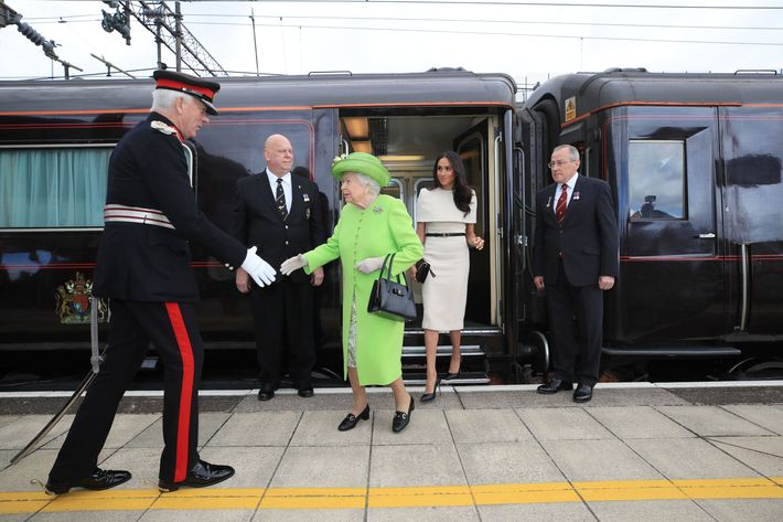 Queen Elizabeth and Meghan Markle leaving the train.