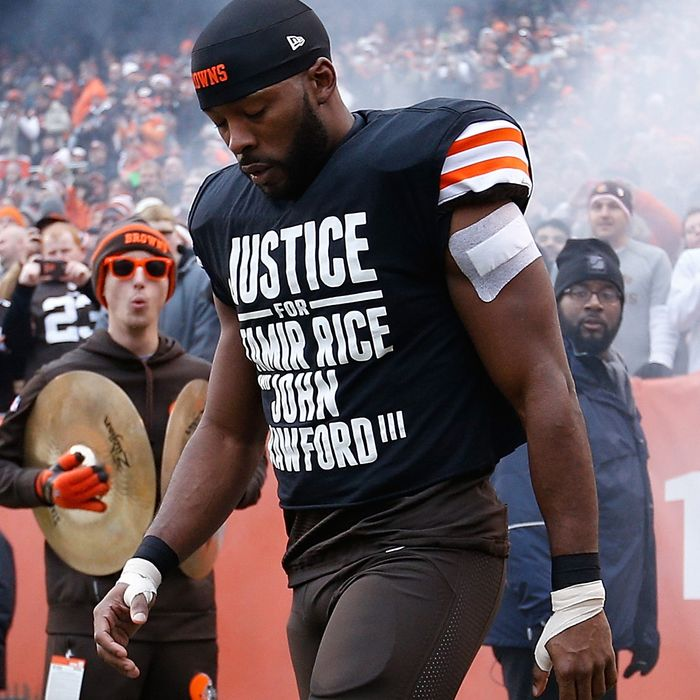 Andrew Hawkins #16 of the Cleveland Browns walks onto the field while wearing a protest shirt during introductions prior to the game against the Cincinnati Bengals at FirstEnergy Stadium on December 14, 2014 in Cleveland, Ohio.