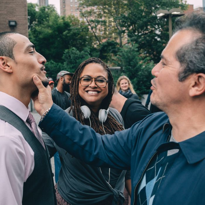 Ava DuVernay on set with When They See Us stars Freddy Miyares and John Leguizamo.