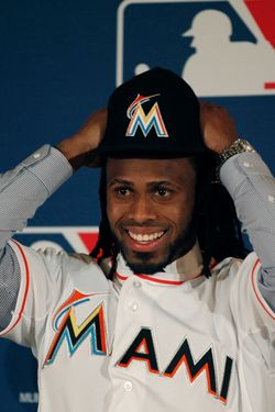 New Miami Marlins Jose Reyes puts on a team cap during a news conference at the Major League Baseball 2011 Winter Meetings in Dallas,  Wednesday, Dec. 7, 2011.  The Marlins unveiled the newly signed free-agent shortstop Reyes. (AP Photo/LM Otero)