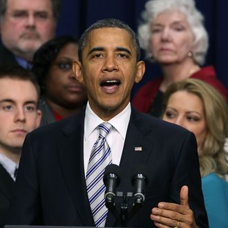 U.S. President Barack Obama speaks in front of workers during an event about the payroll tax cut extension