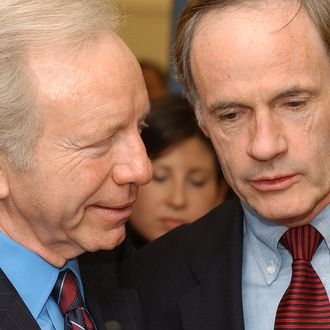 NEWARK, DELAWARE - DECEMBER 19: U.S. Sen. and Democratic Presidential candidate Joseph Lieberman (D-CT) (L) and Senator Tom Carper (D-DE) (R) speak at M Cubed Technologies on Decemeber 19, 2003 during a campaign swing thru Delaware. M Cube Technologies manufactures the material used in bullet proof vests used by the Military. (Photo by Jeff Fusco/Getty Images)