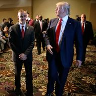 Republican presidential candidate Donald Trump walks with his campaign manager Corey Lewandowski, left, after speaking at a news conference, Tuesday, Aug. 25, 2015, in Dubuque, Iowa.